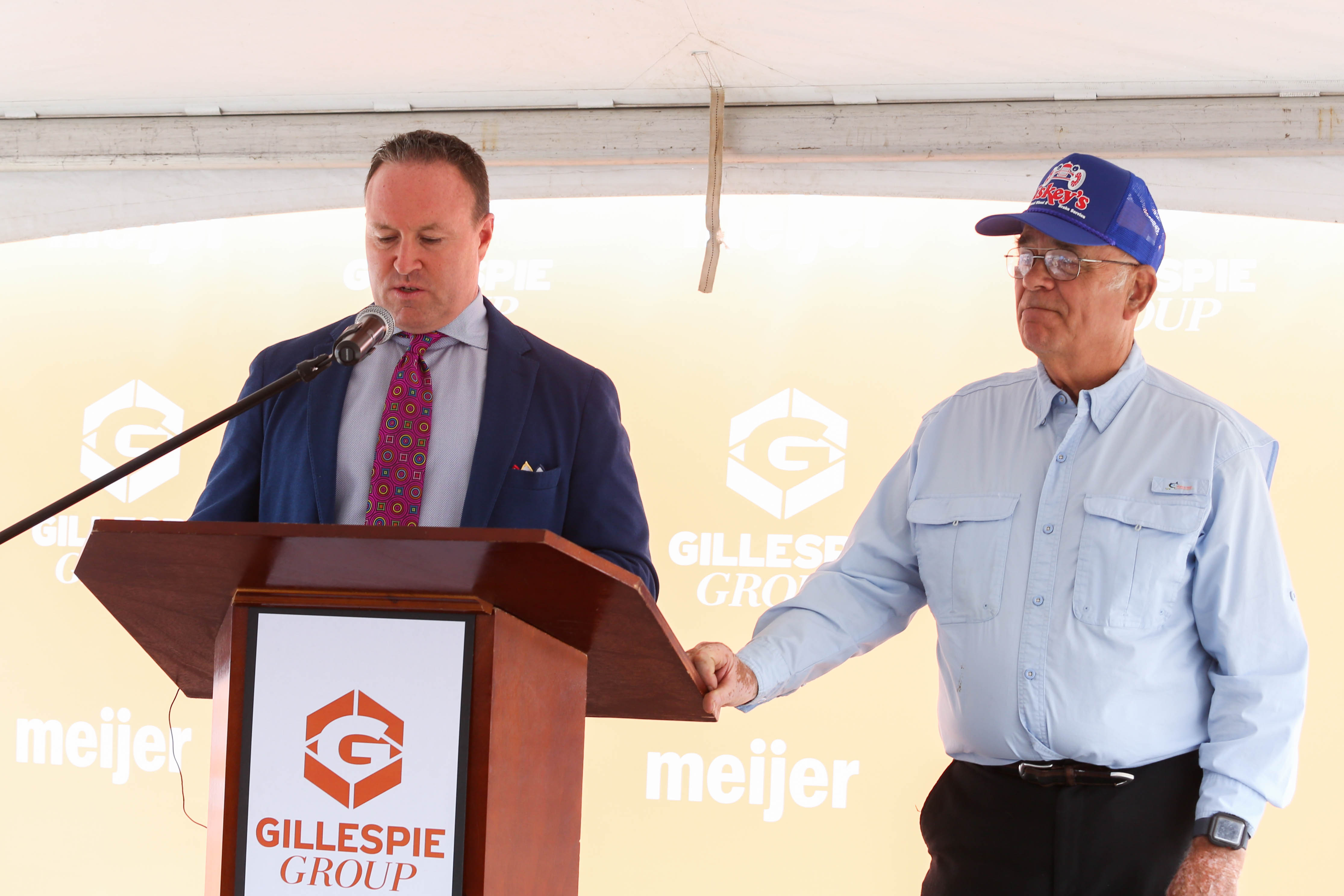 Pat Gillespie and Ed Carpenter, owner of Liskey's, speak at the downtown 600 E Michigan project announcement