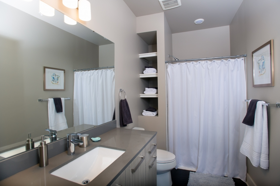 bathroom with white walls mirror and white shower curtain