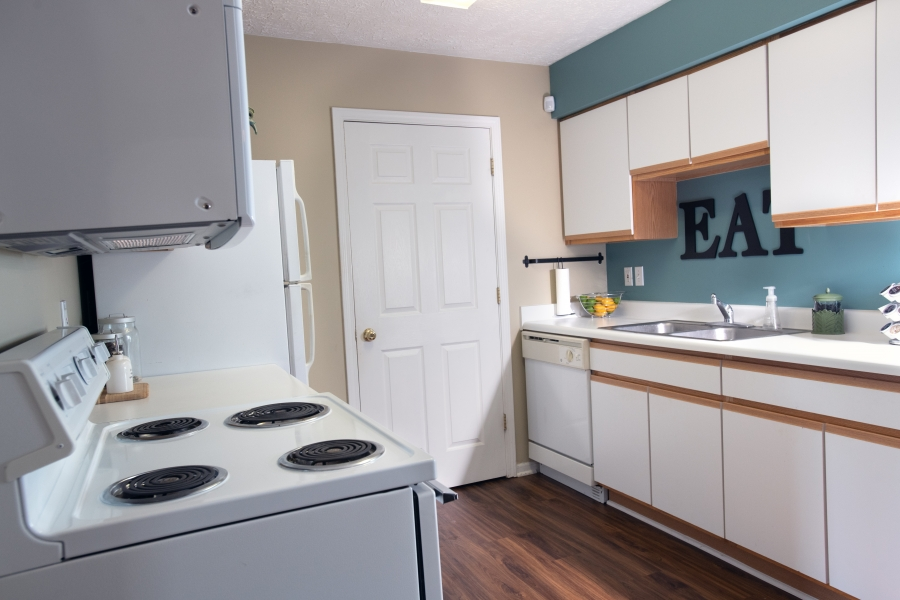 view of kitchen with wood floor and white appliances