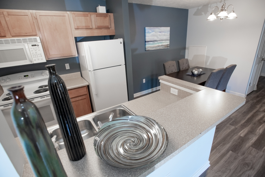 kitchen view of grey counter and white appliances