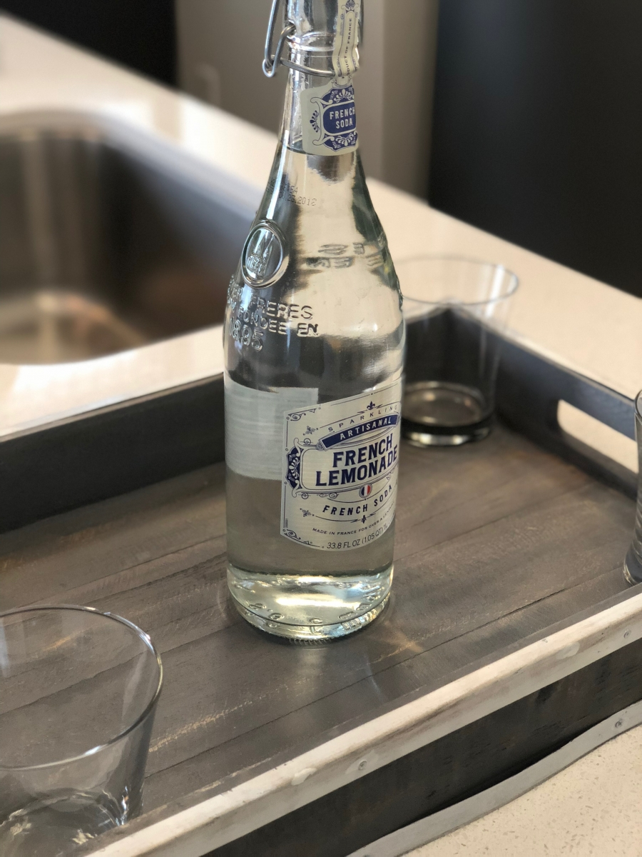 bottle of water on wood counter
