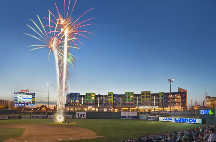 view of outfield from baseball field with fireworks in background